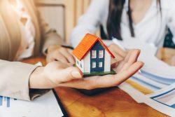Modellhaus und Finanzierungspläne